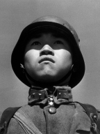CHINA. Hankow. 1938. A teenage Chinese soldier. In July 1937 Japan ordered an attack on China. The Japanese rapidly conquered all northern China, up to the Yangze river. CHIANG KAI-SHEK, President of China, and head of the Nationalist Party, moved the capital to Chongqing, while Japan established a puppet government in Nanjing. In July 1945 China, helped by the 14th US Air Force, staged a national counter-offensive against the Japanese, who surrendered in September 1945.